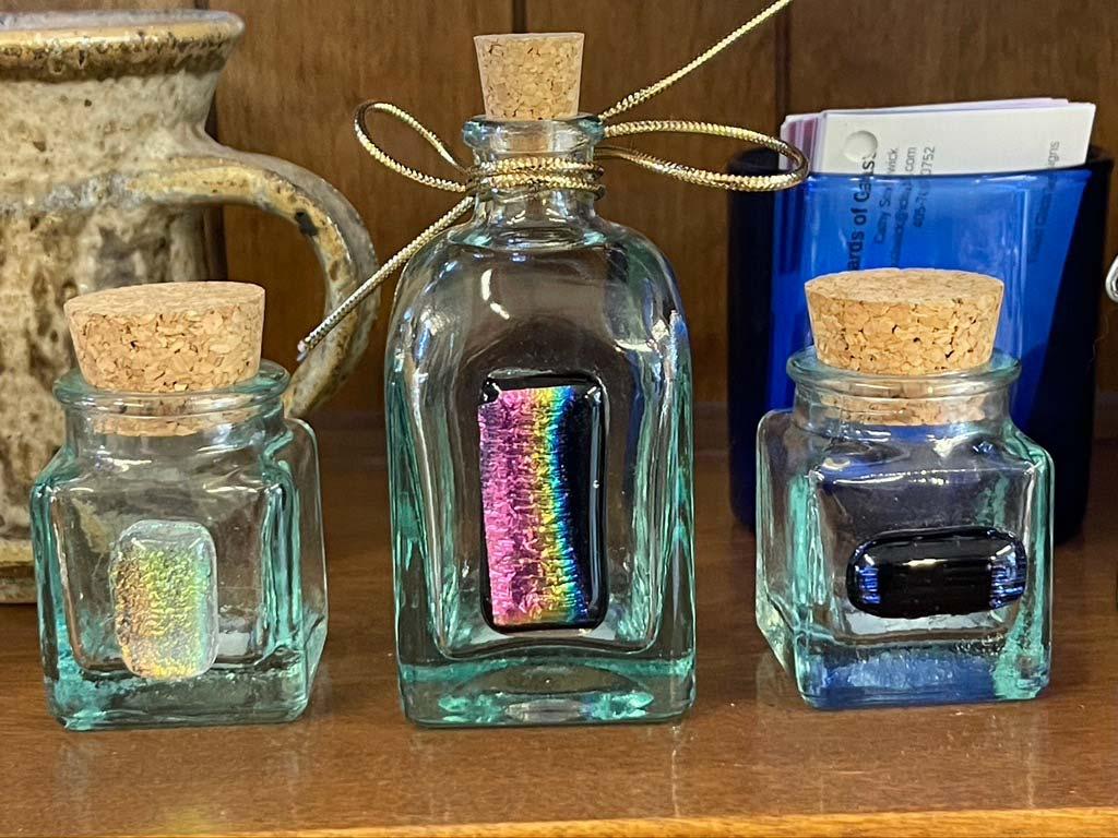 three corked bottles